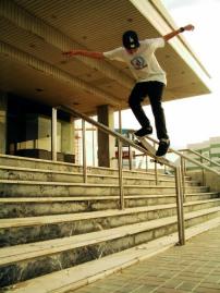 Skater Colom Noonan doing a f/s feeble down Al Nasar Cinema handrail, Dubai, UAE.