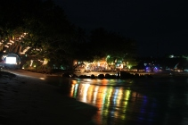 Beach coated in colours at night in Mirissa, Sri Lanka.